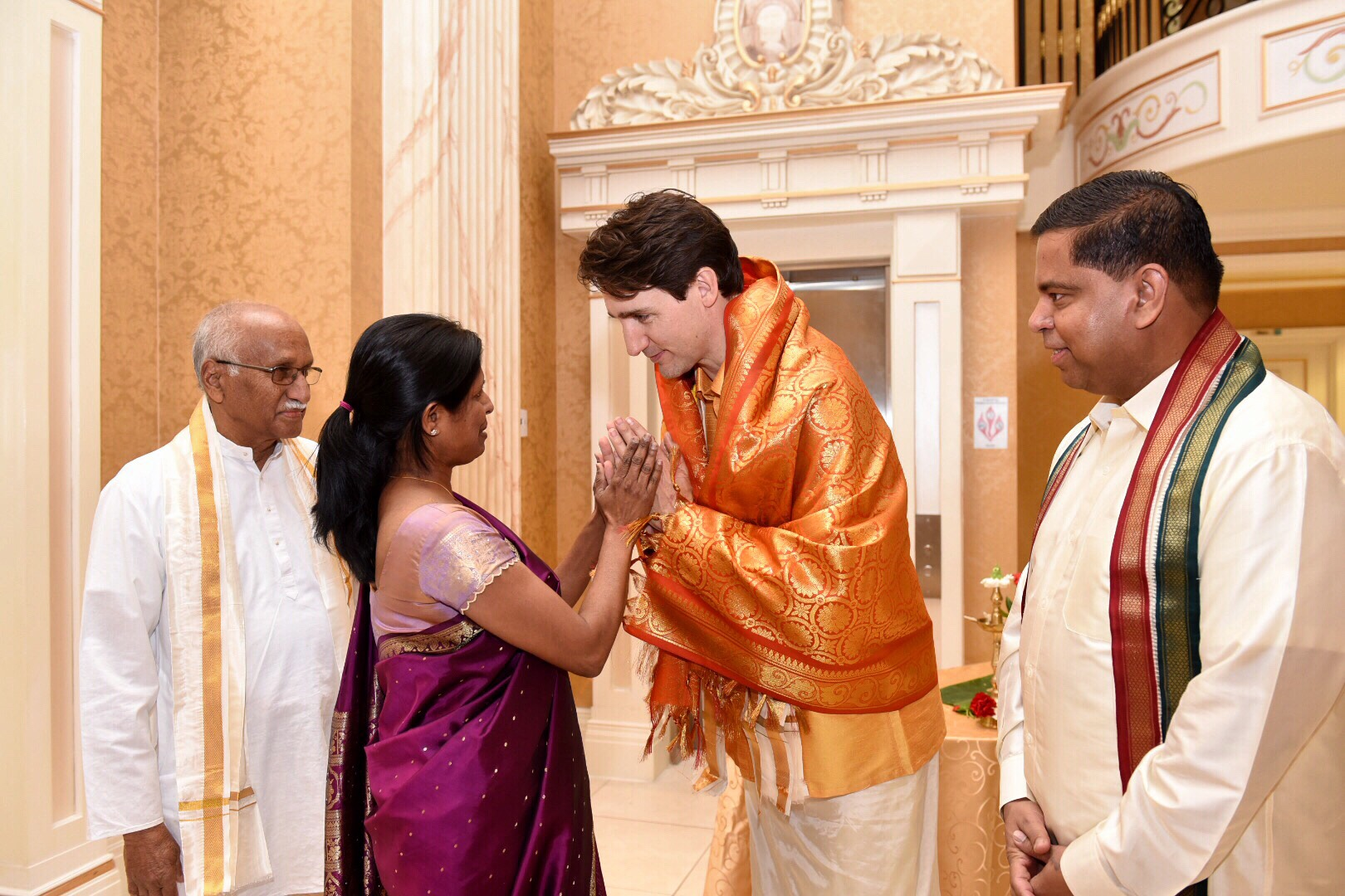 Canada prime minister celebrates thai pongal with tamil community prime minister trudeau receiving a traditional tamil welcome with liberal mp gary anandasangaree right kristyandbryce Images